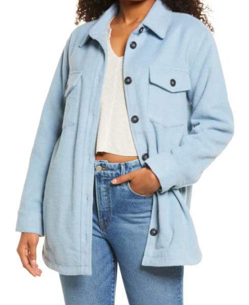 A model wearing the shirt jacket in sky blue