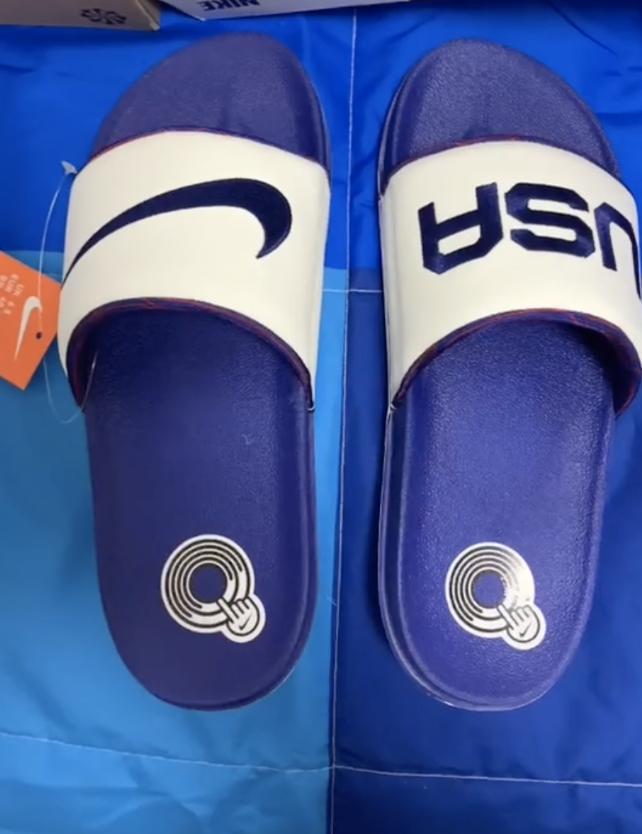 """The left slide has the """"swoosh"""" logo and the right side has """"USA"""" written on it"""