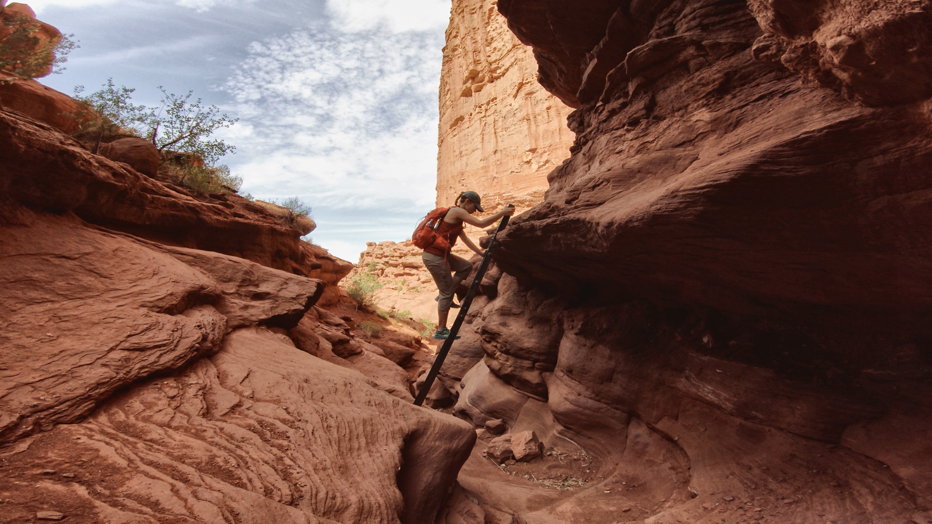 A hiking climbing in Canyonlands National Park