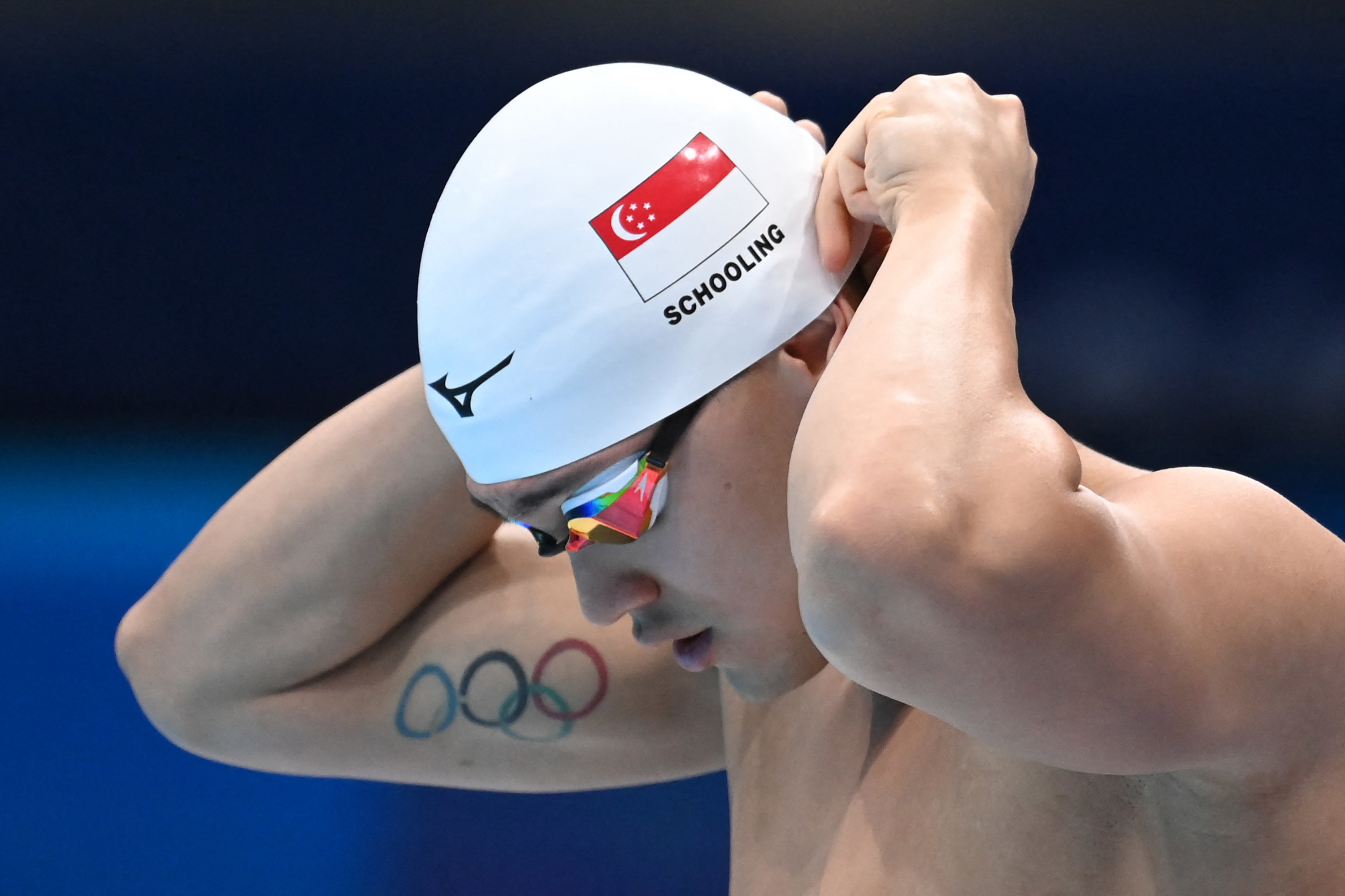 Candid view of a male swimmer from Singapore preparing to compete.
