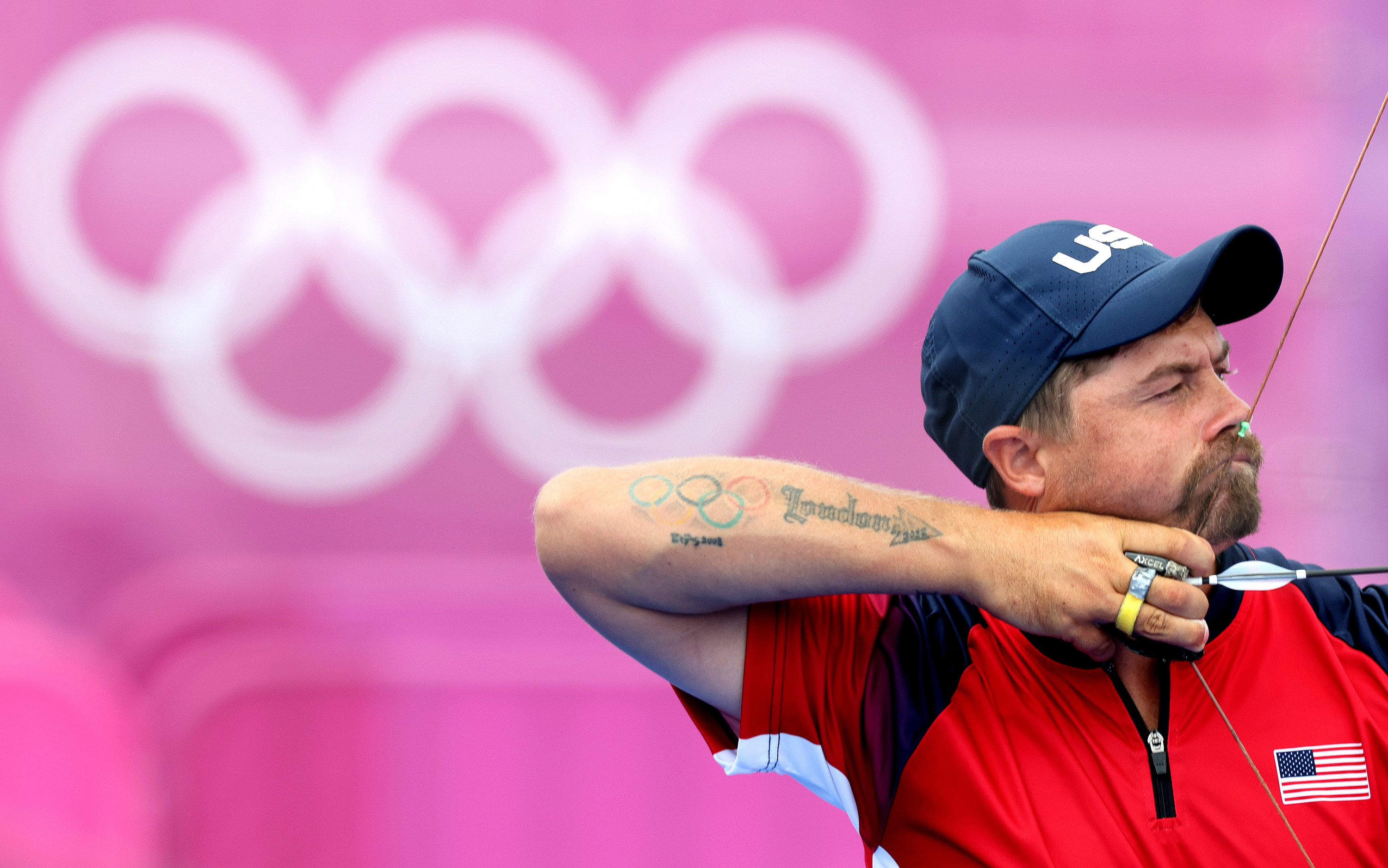 Close-up look at athlete holding bow and arrow