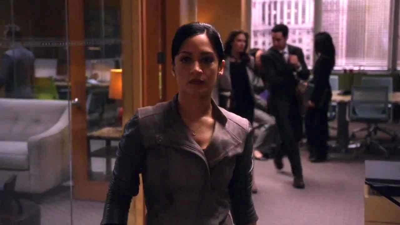 kalinda wears a suit, walks through an office