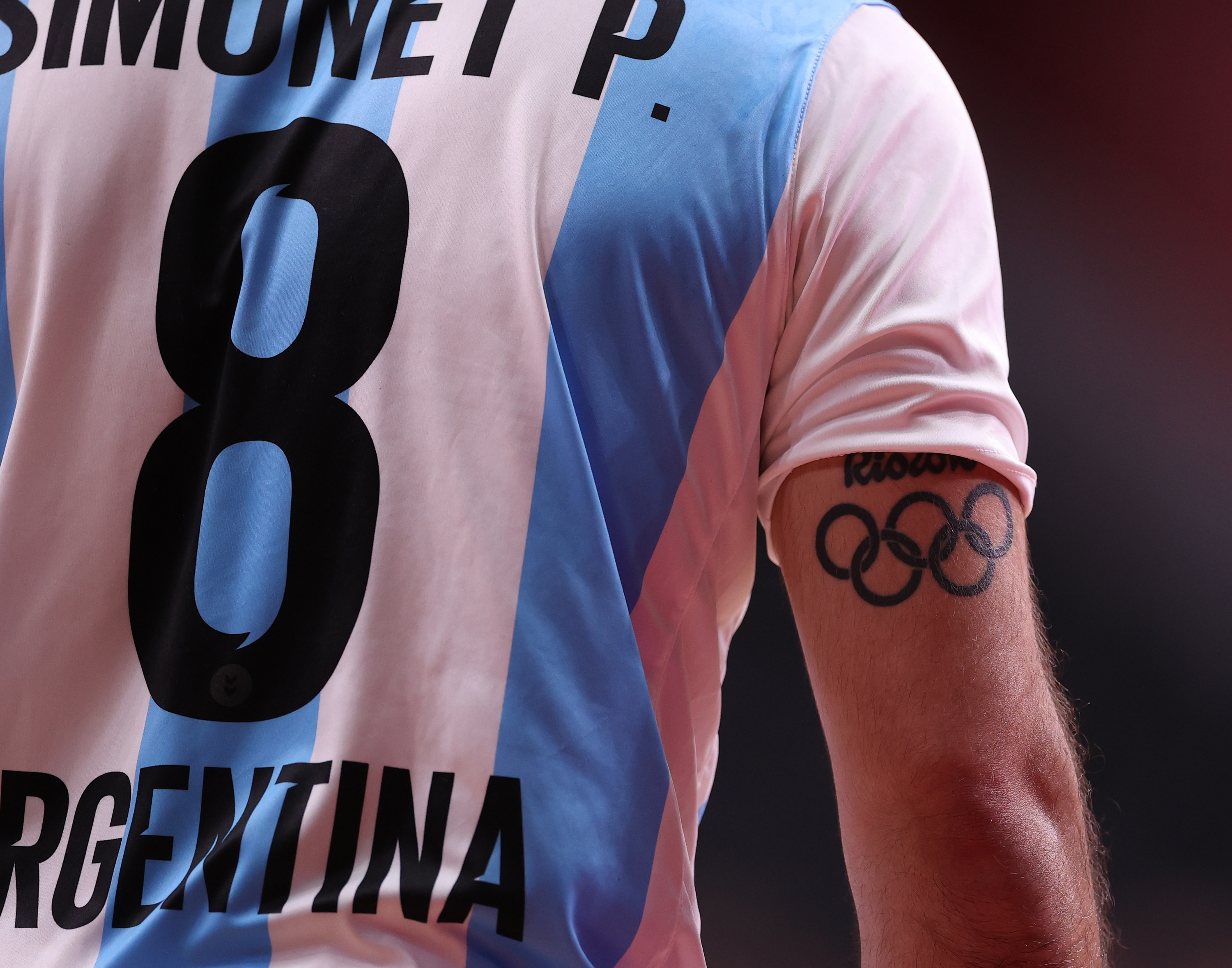 Close-up of Argentinian athlete's back, jersey and arm tattoo