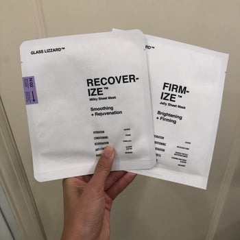 buzzfeed editor holding the recover-ize and firm-ize sheet masks