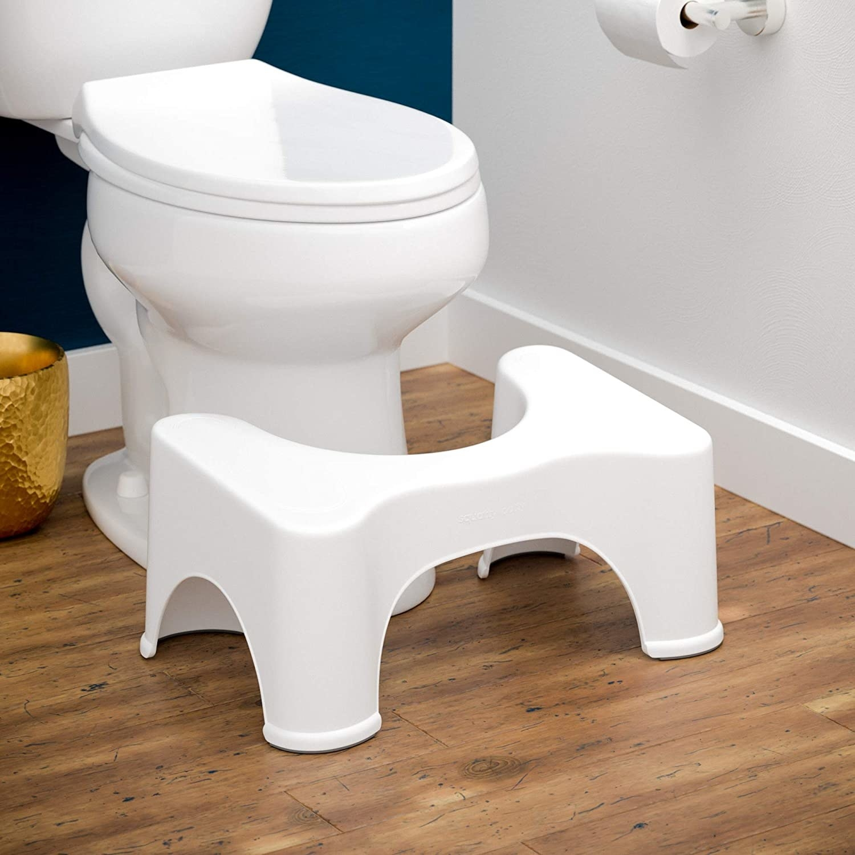 White squatty potty on bathroom floor