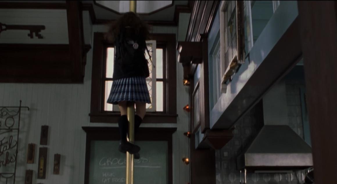 Mia takes a firemen's pole downstairs