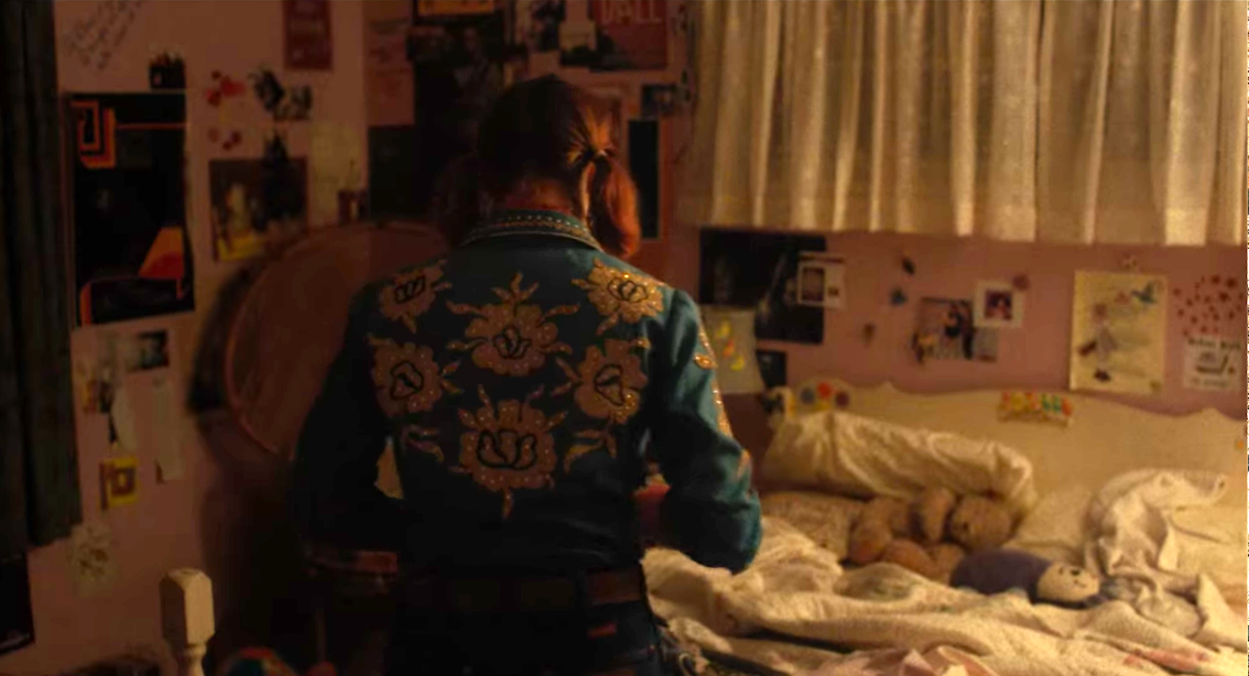Lady Bird in her pink, very decorated bedroom