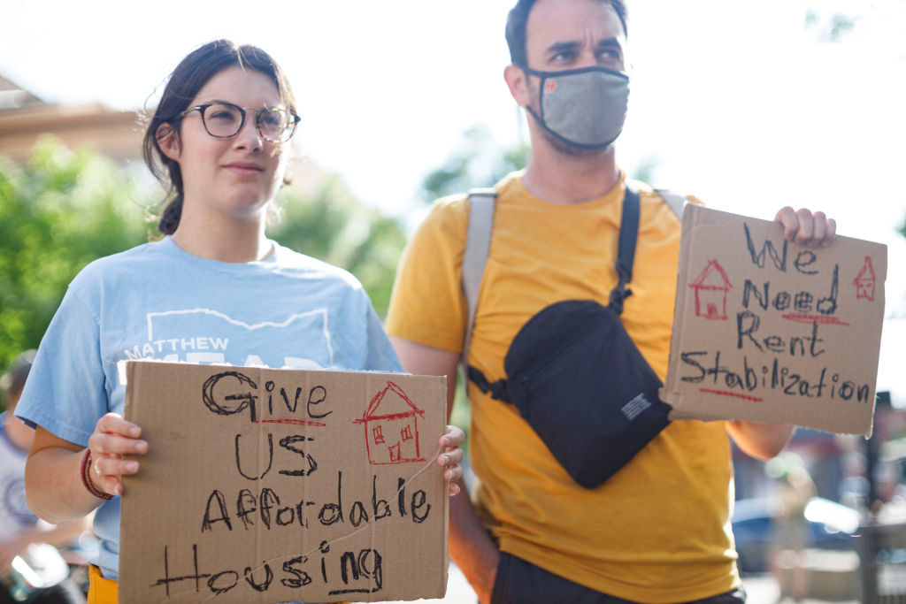 Protesters in Ohio holding signs calling for affordable housing and rent stabilization