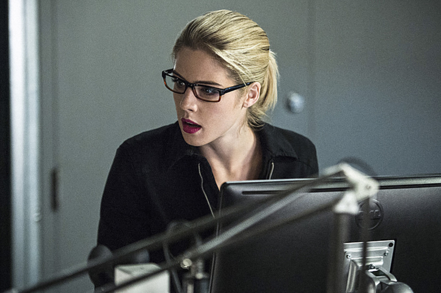 Felicity sitting at a computer