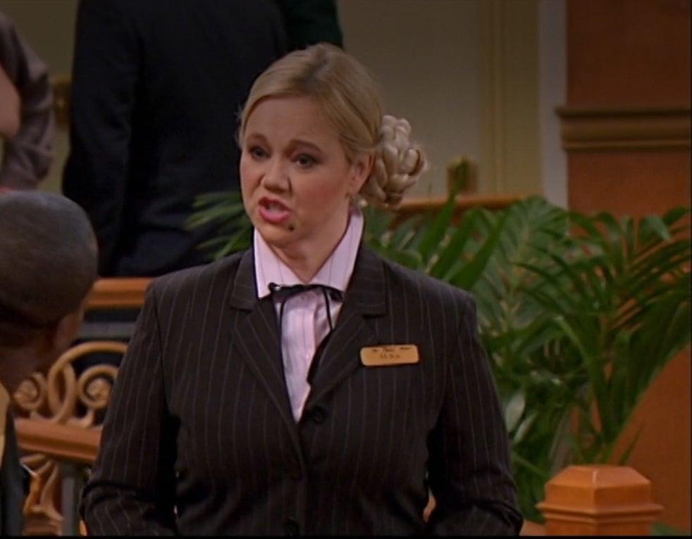 Caroline Rhea dressed as a hotel inspector