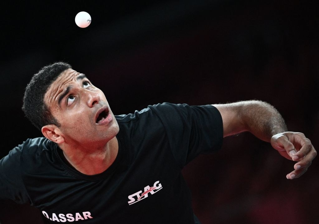 An athlete looks up at the ball