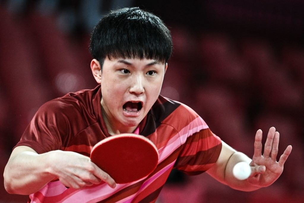 An athlete with an intense stare on their face