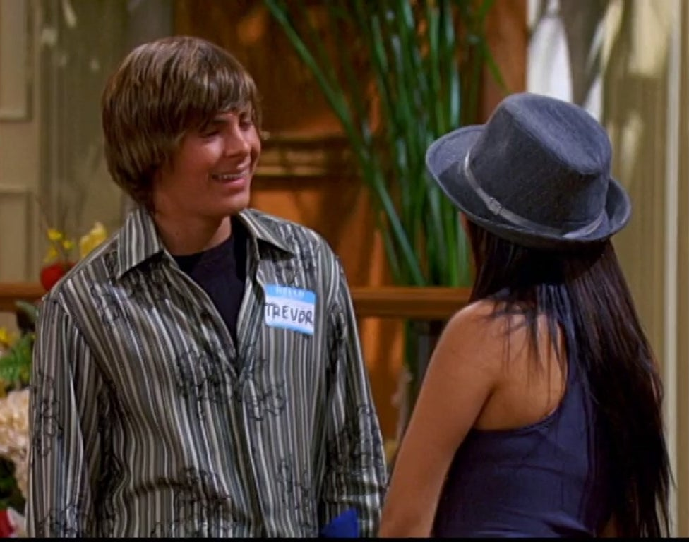 Zac Efron talks to Brenda Song in the Tipton lobby