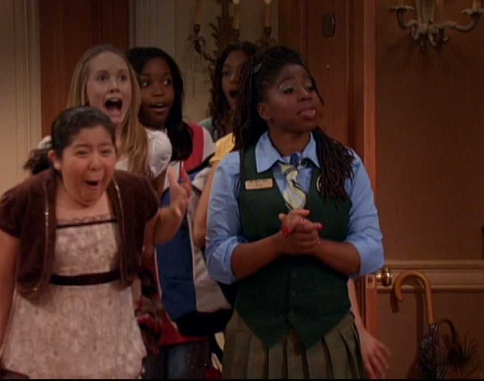 Raini Rodriguez excitedly runs into a room with a bunch of girls