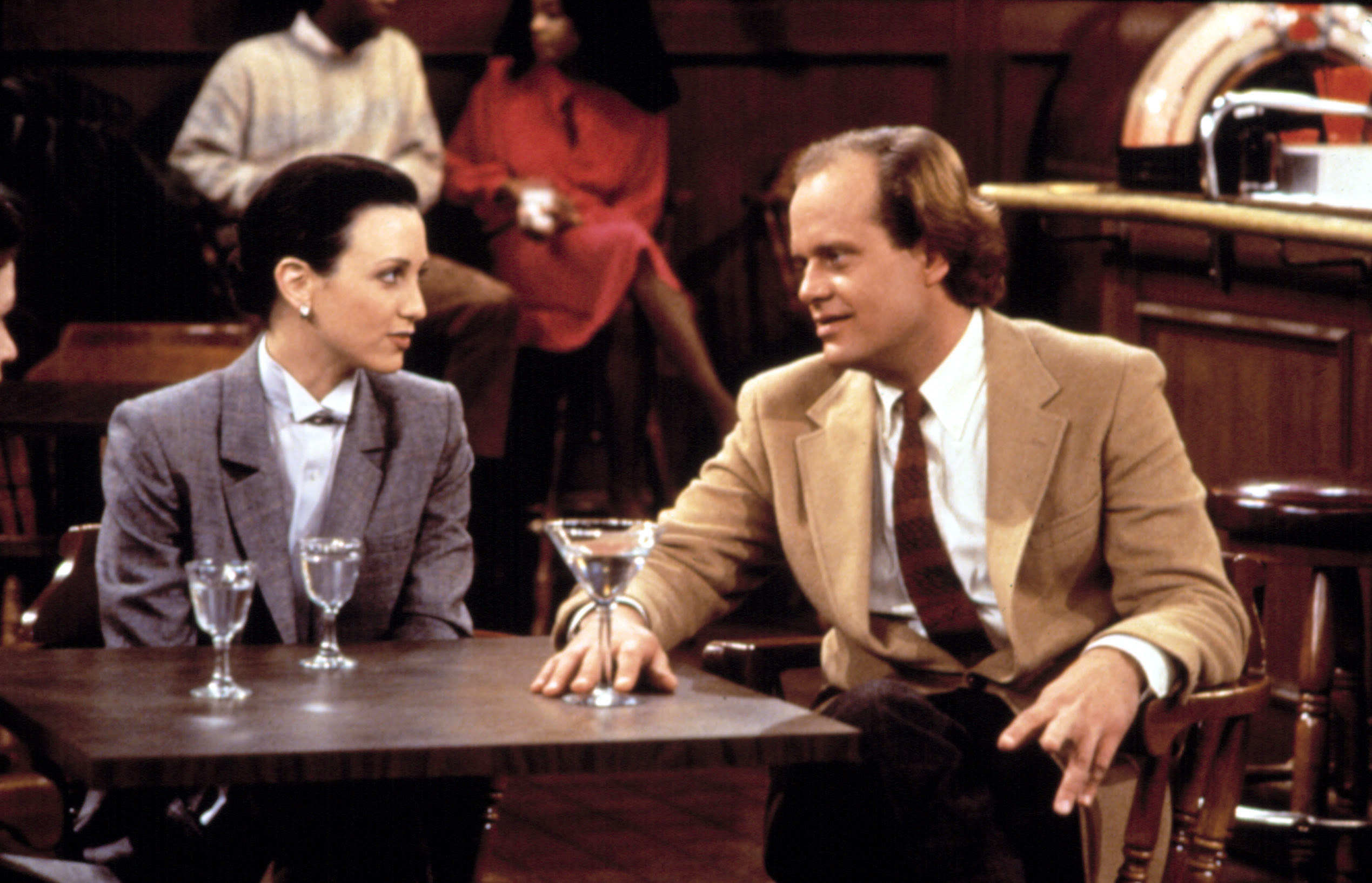 """Frasier and Lilith having a drink in """"Cheers"""""""