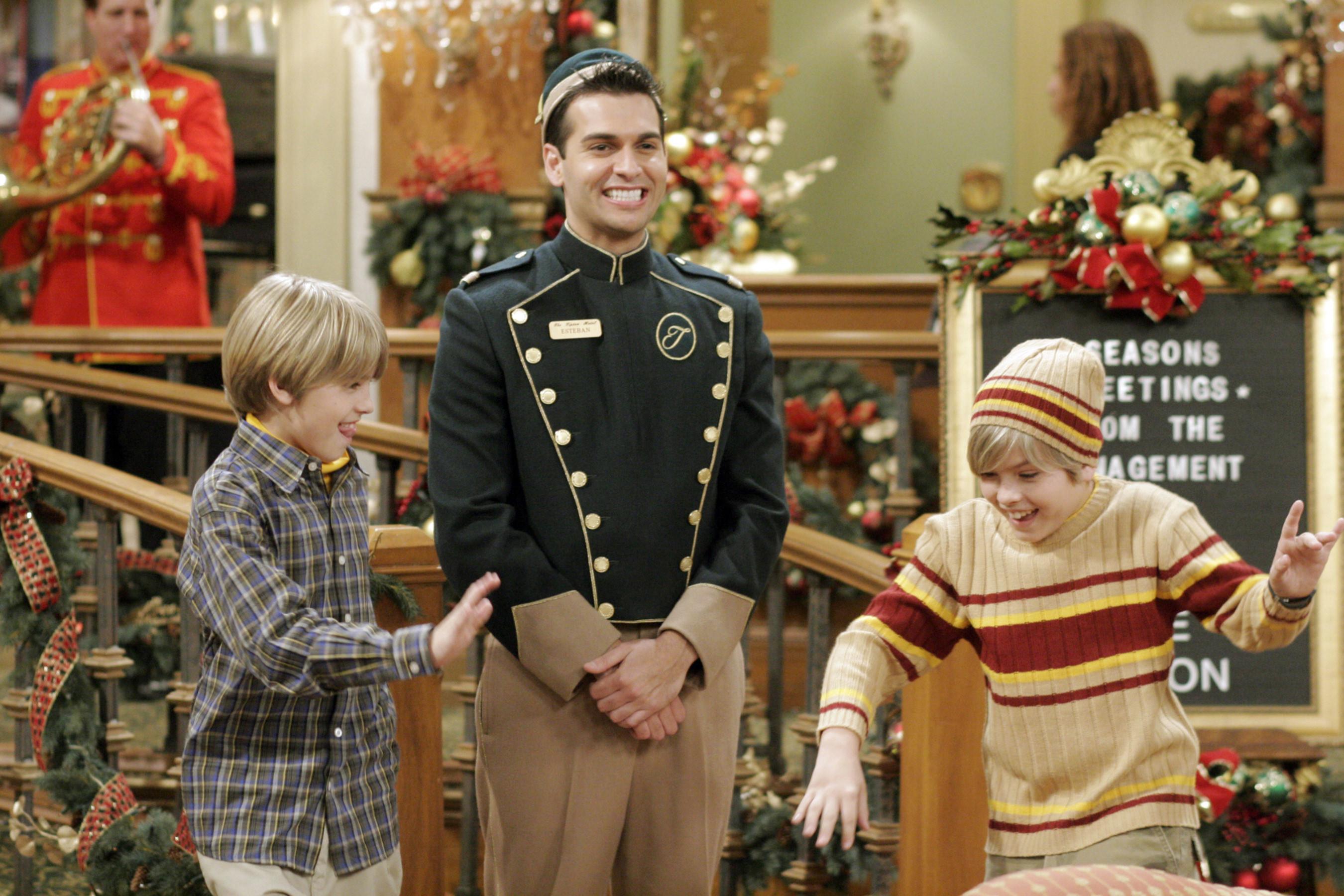 Esteban smiling next to Zack and Cody