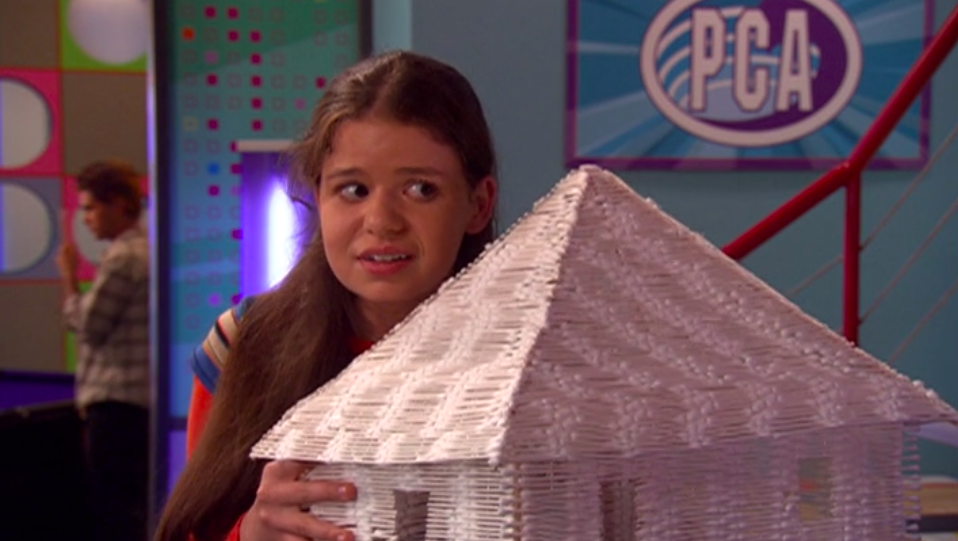 Stacey holding up a house made of cotton swabs