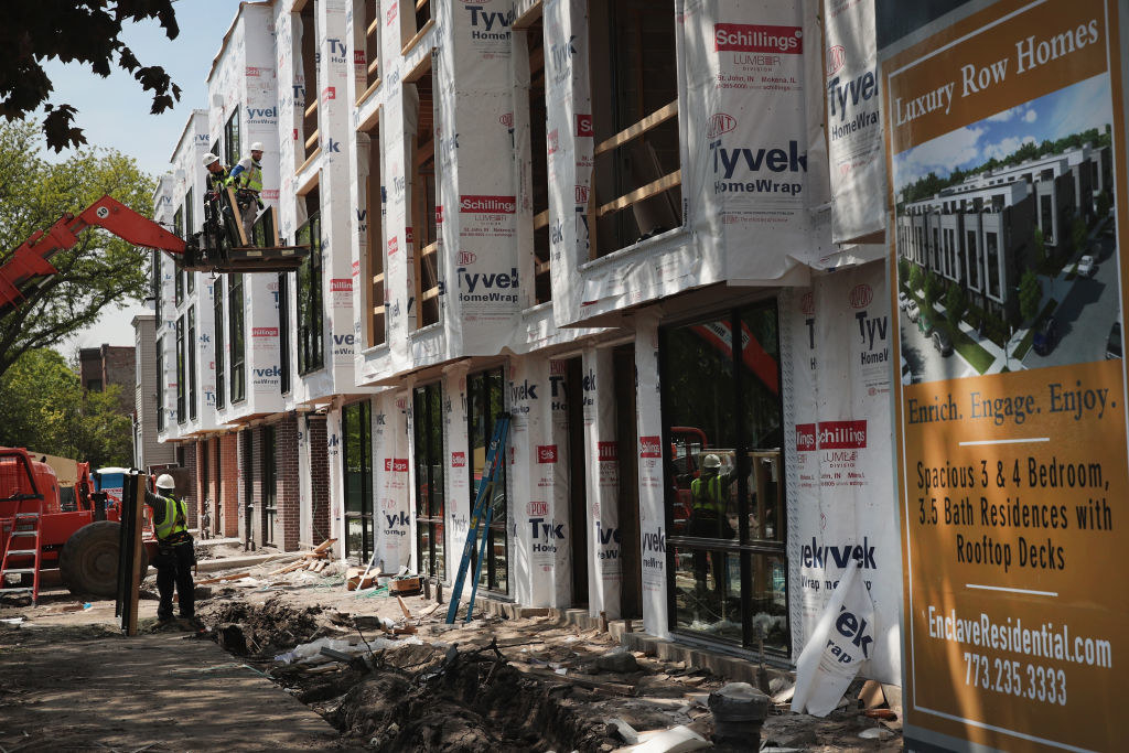 Workers building new luxury row homes in Chicago