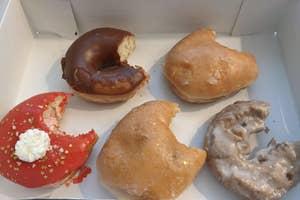 five donuts with a single bite taken out of each of them