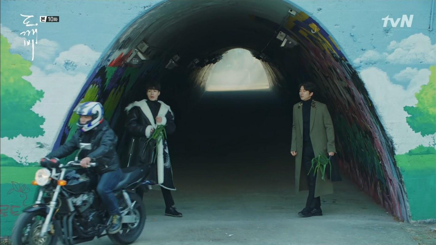 Men walking through a tunnel