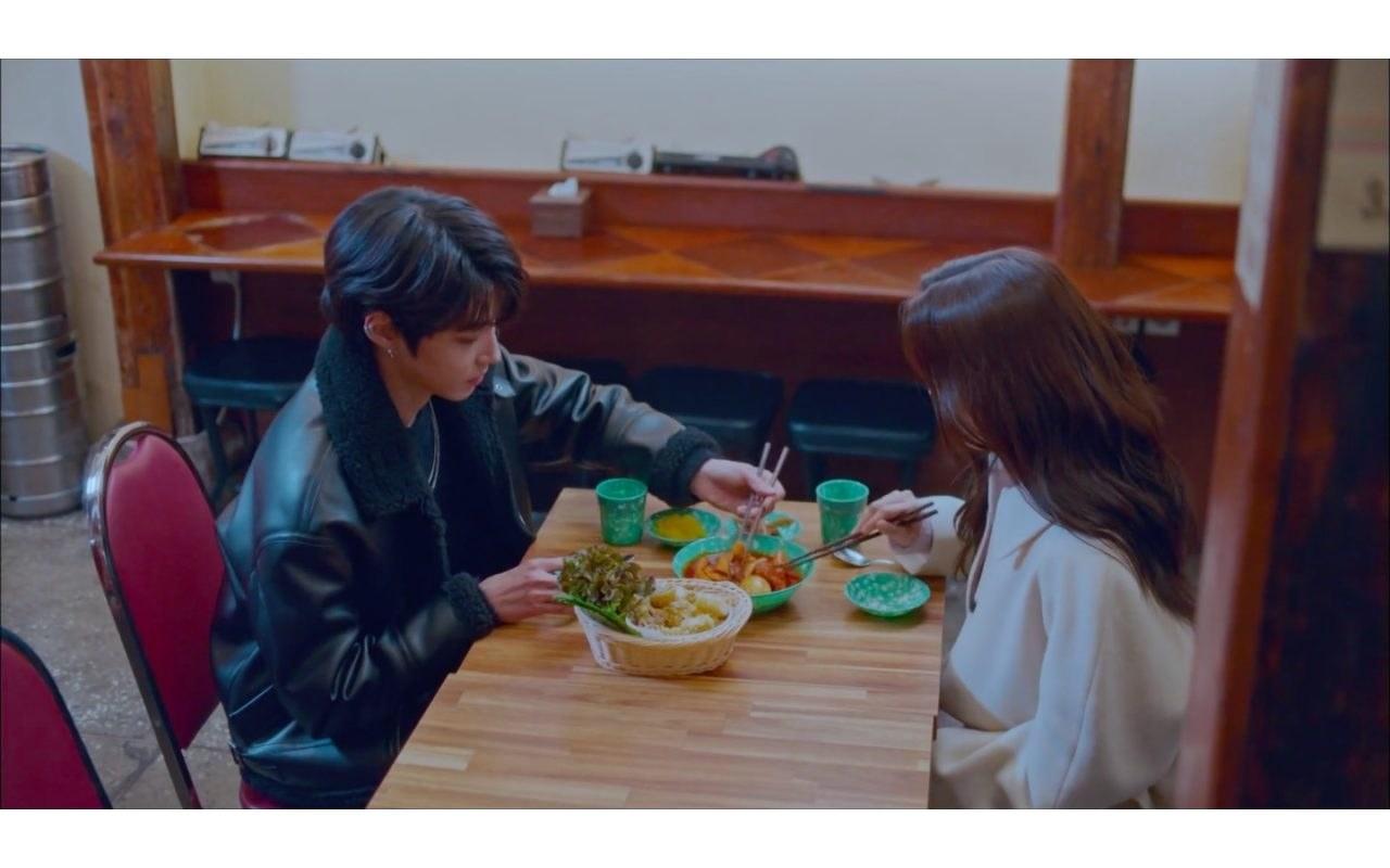 Man and woman eating at Korean restaurant