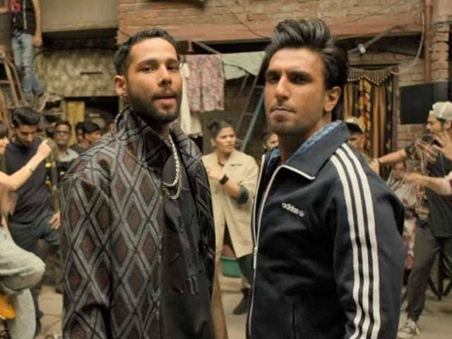 Ranveer singh and siddhant chaturvedi's characters stare into the camera in a still from the movie gully boy