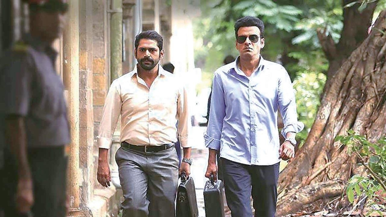 In a still from the family man, Jk talpade and srikant walk with briefcases