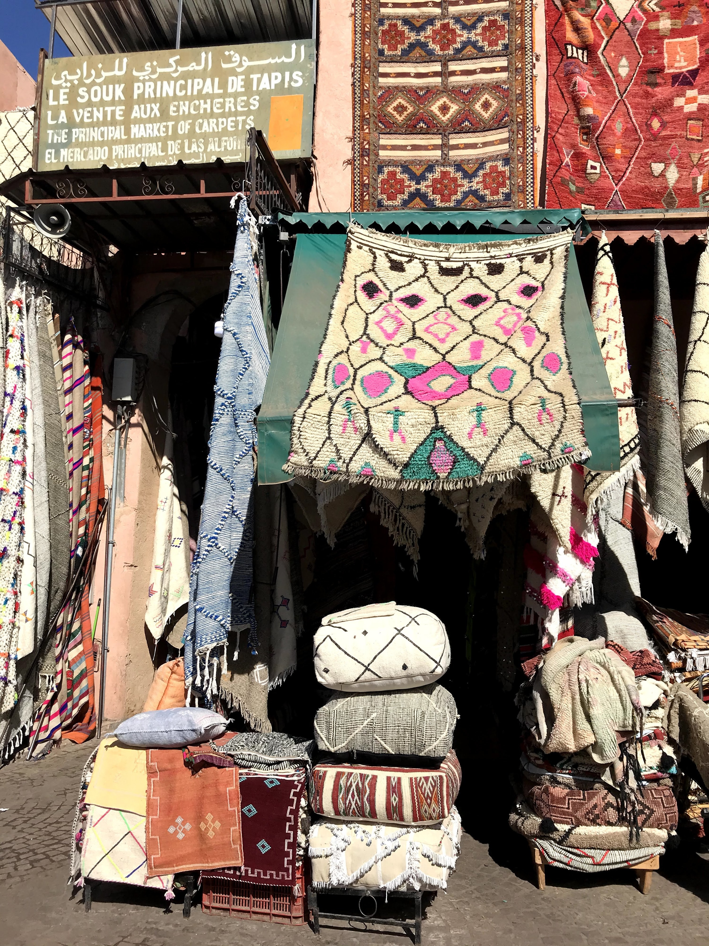 Souk with blankets, rugs, and pillows