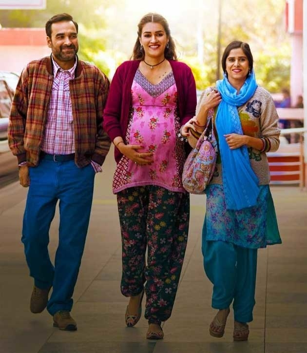 A pregnant mimi, bhanu, and shama in a still from the movie mimi