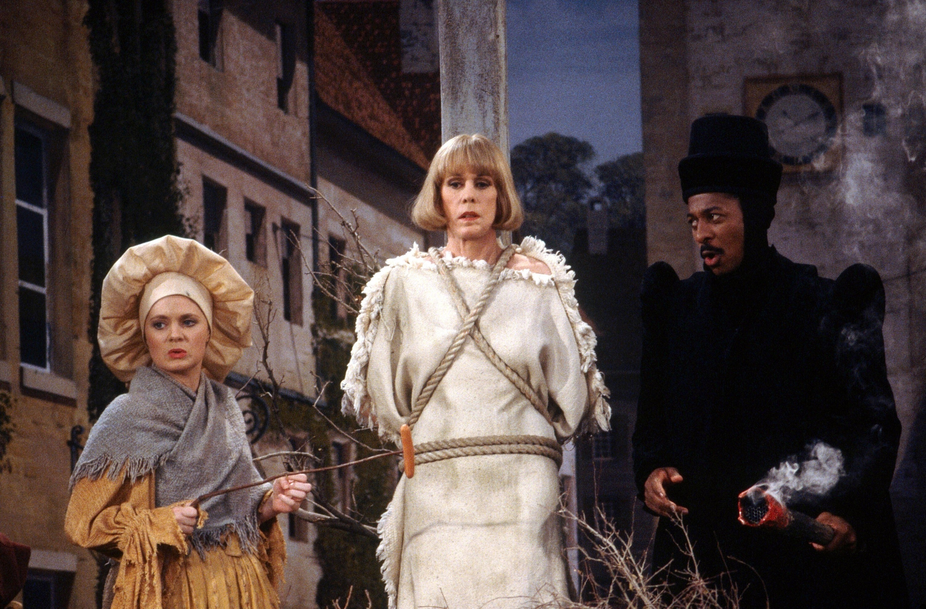 Meagen Fay, Carol Burnett, and Robert Townsend perform a burning at the stake sketch