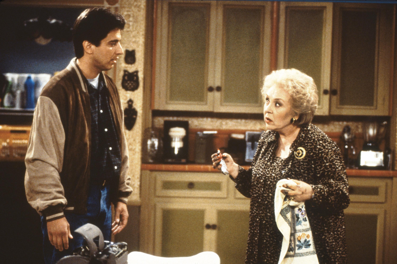 Ray Romano talks to Doris Roberts in the kitchen
