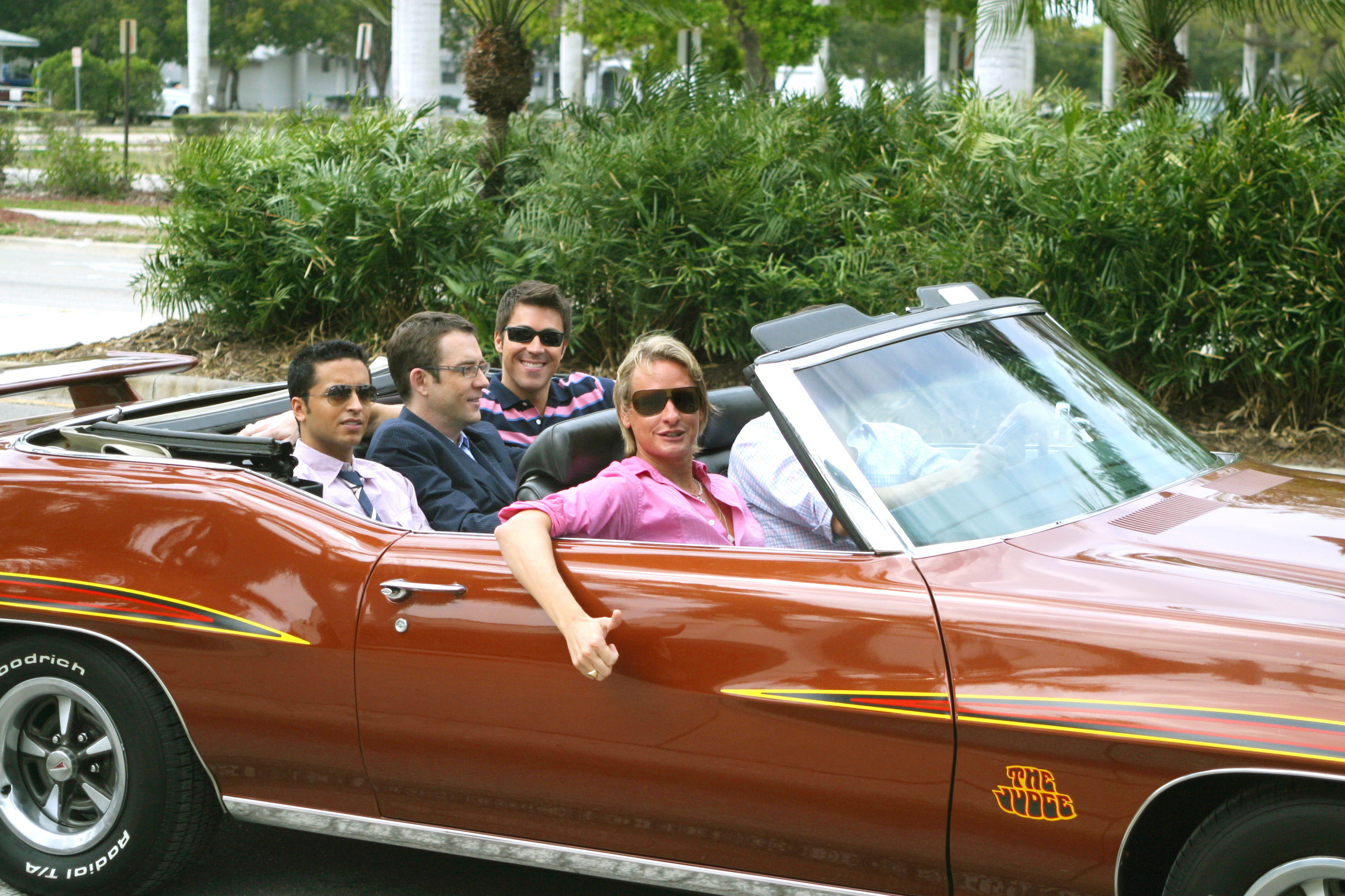 Jai Rodriguez, Ted Allen, Kyan Douglas, Carson Kressley, and Thom Filicia ride in a convertible
