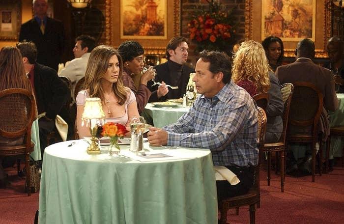 Jennifer Aniston as Rachel Green, Jon Lovitz as Steve on a date on Friends