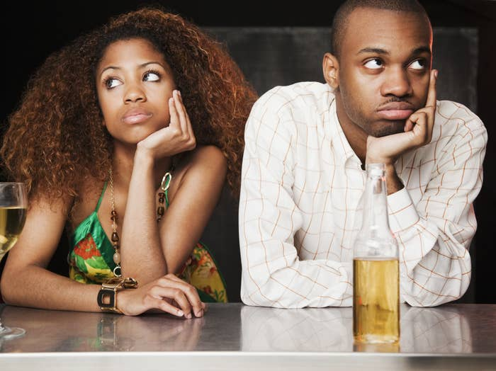 Couple having bad date at bar