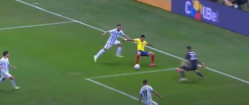Columbian soccer player kicks ball while falling backward