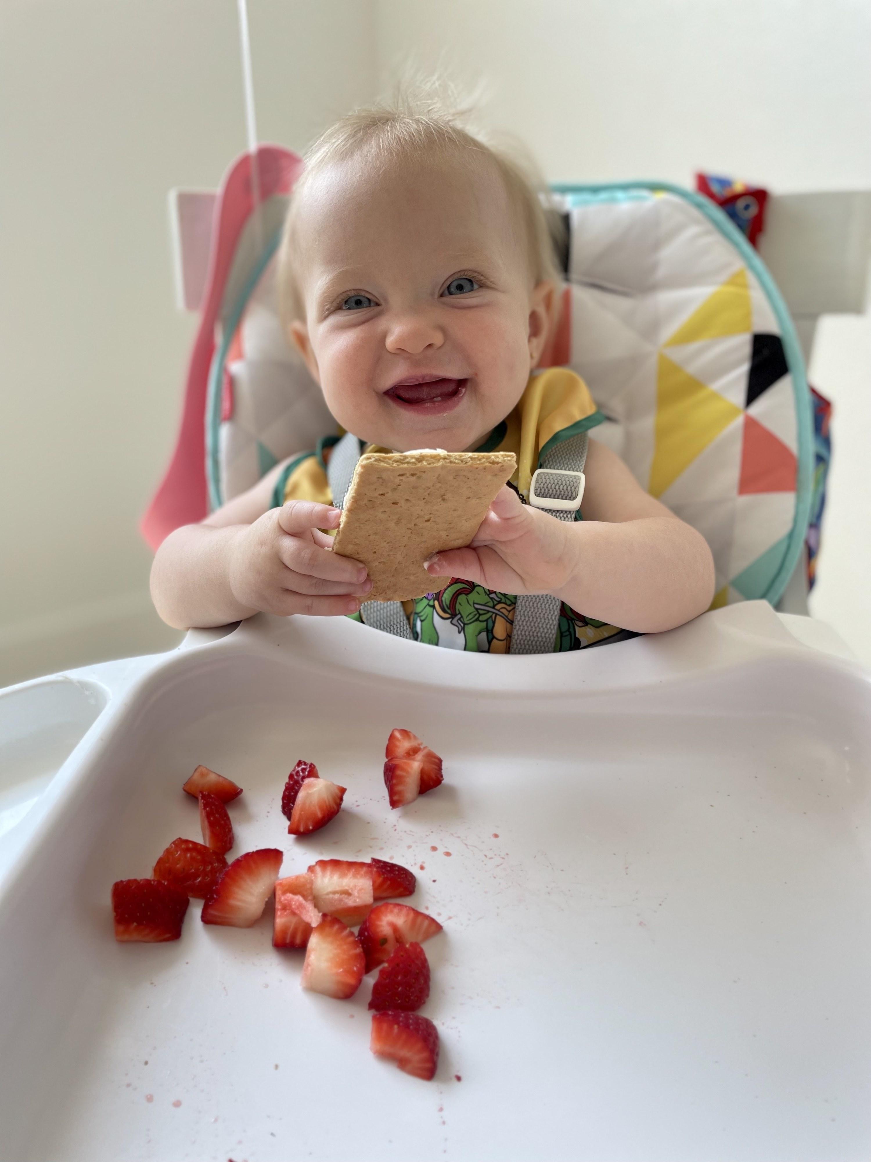The author's daughter enjoying cheesecake crackers