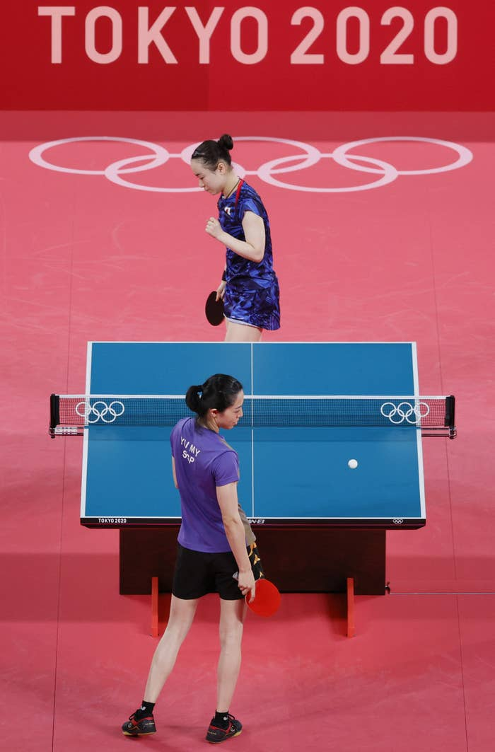 Two opponents during a table tennis match