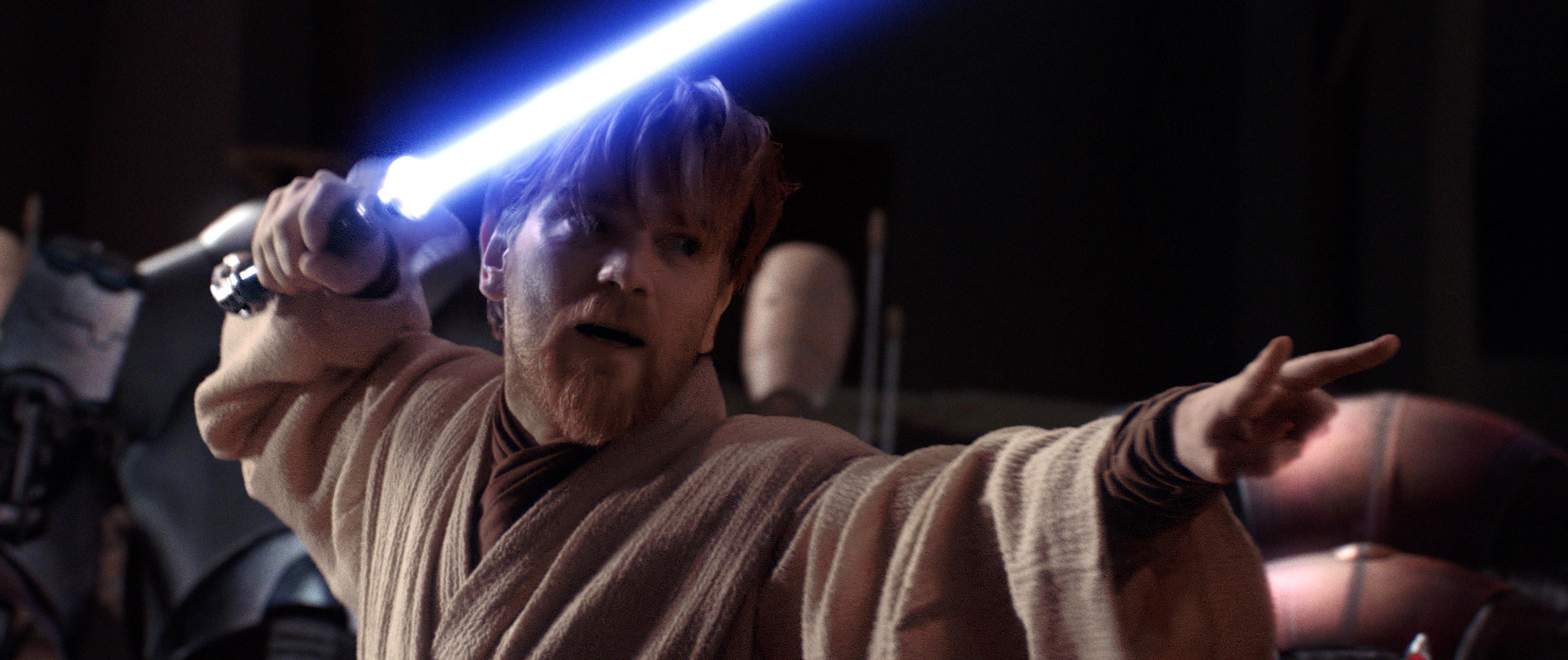Ewan McGregor holding a lightsaber.