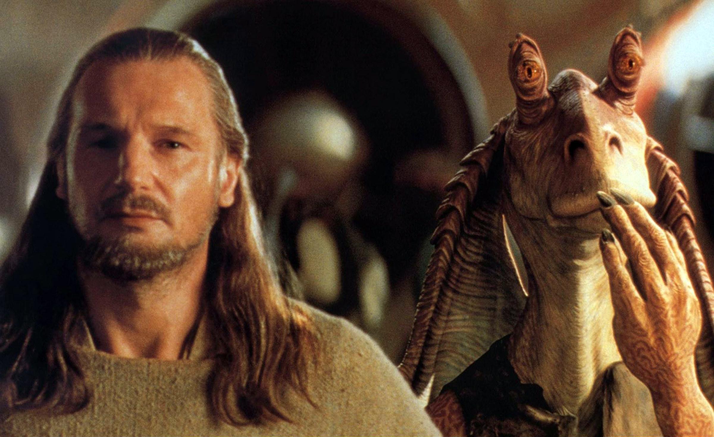 Liam Neeson looking annoyed at Jar Jar Binks.