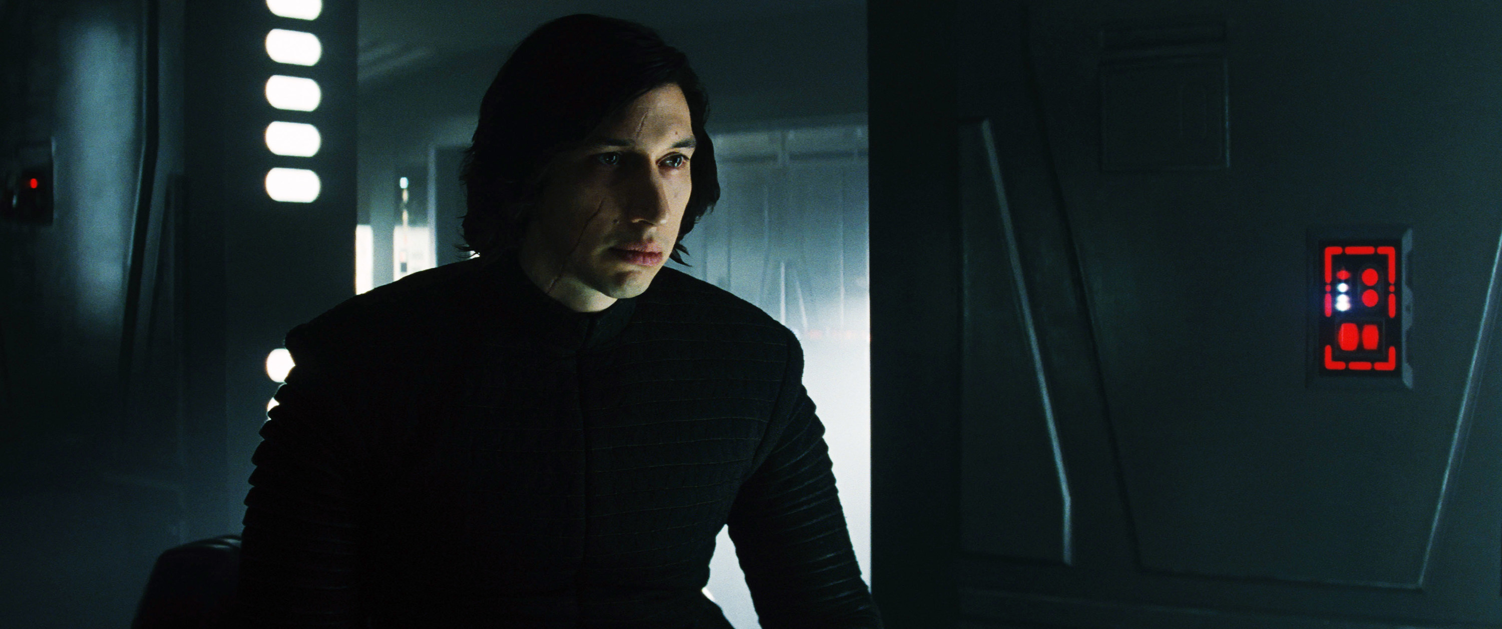 Adam Driver staring blankly into the distance