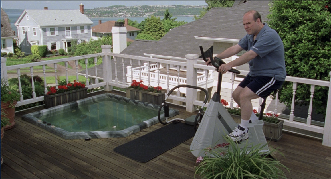 Mr. Stratford exercising on the porch, next to the hot tub
