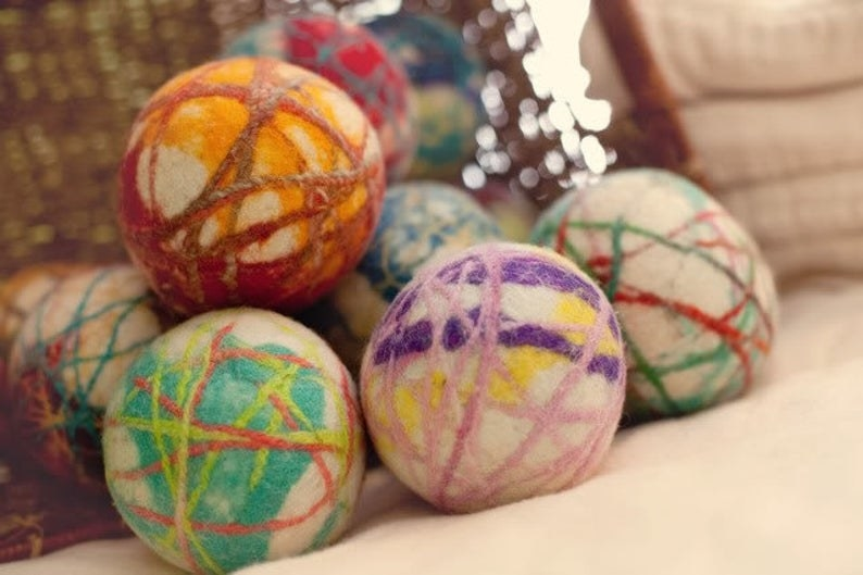 dryer balls with colorful stripes all over them