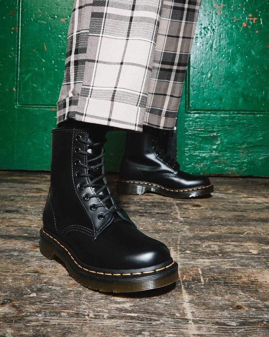 model wearing black doc marten combat boots