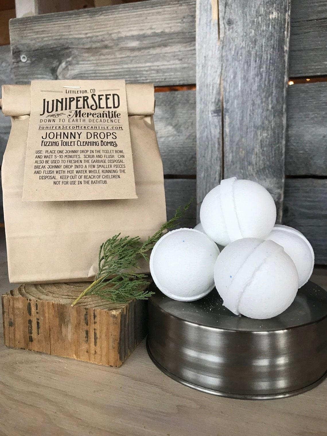 the white toilet bombs shaped like balls beside the bag