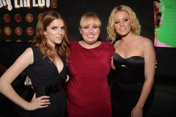 Rebel posing for a photo with two of her Pitch Perfect costars