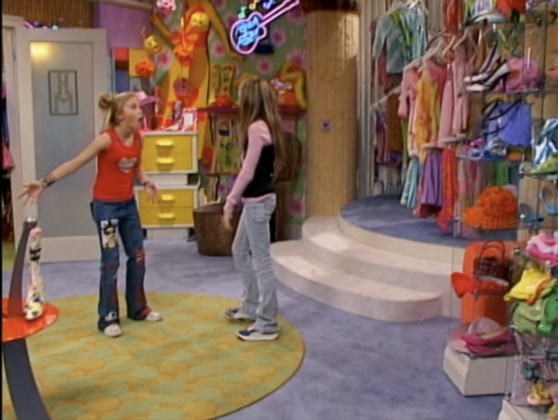 Hannah and her friend in a massive walk-in closet