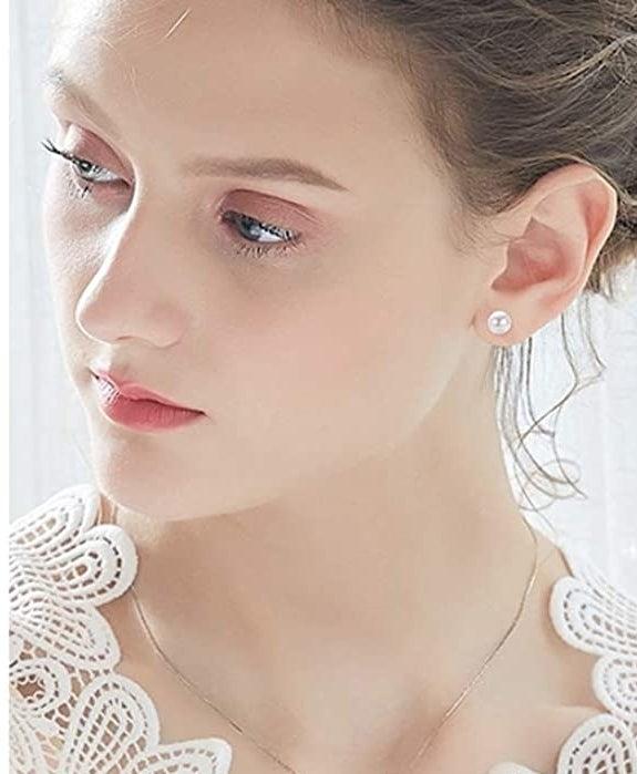 model wearing a faux pearl earring on their ear