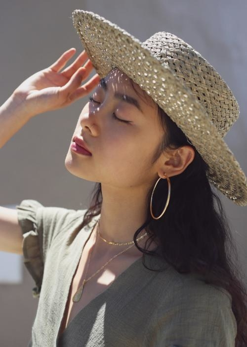 model wearing large gold hoops on their ears