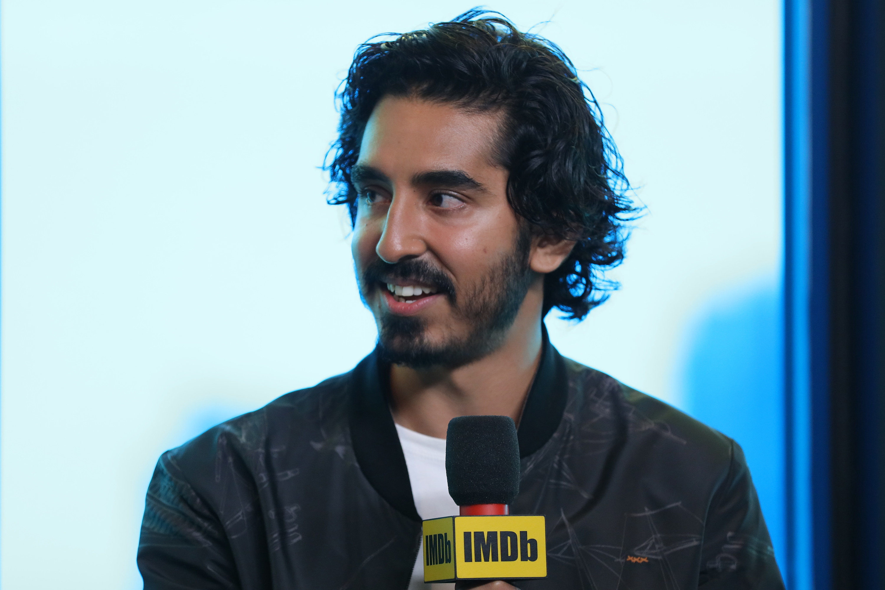 Dev Patel speaks at an event in 2019