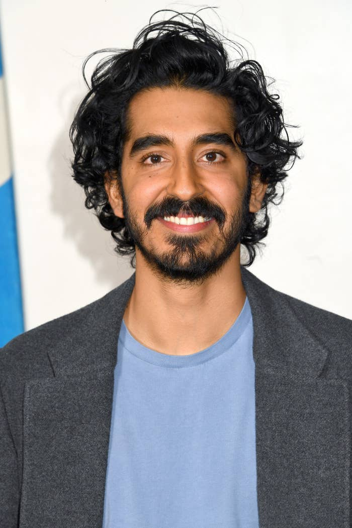 Dev Patel is pictured smiling at a movie screening in London in 2019